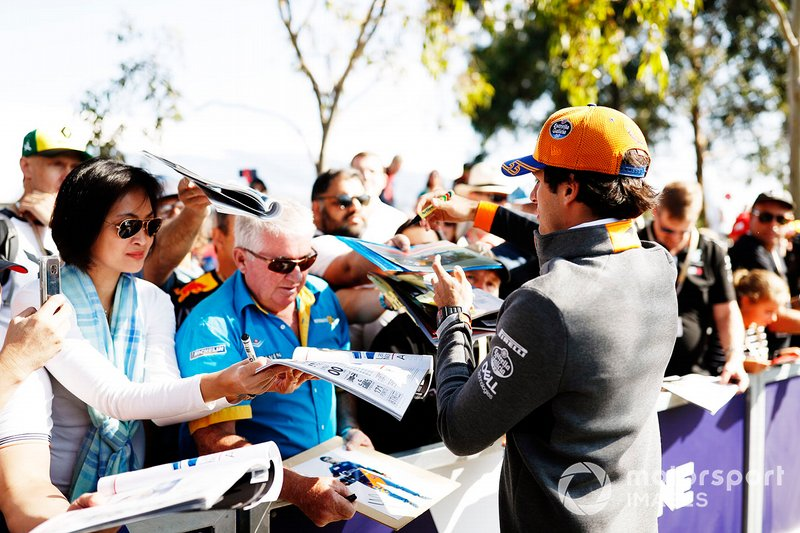 Carlos Sainz Jr., McLaren, signs autographs for fans