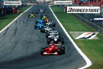 Michael Schumacher, Ferrari F1-2000, leads after the pace car returned to the pits