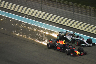 Max Verstappen, Red Bull Racing RB14 and Lewis Hamilton, Mercedes-AMG F1 W09 sparks and battle