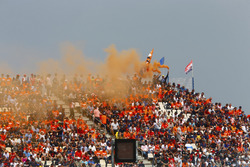 Dutch fans set off flares in a grandstand