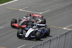 Fernando Alonso, McLaren MP4-22, attempts a pass on Alex Wurz, Williams FW29