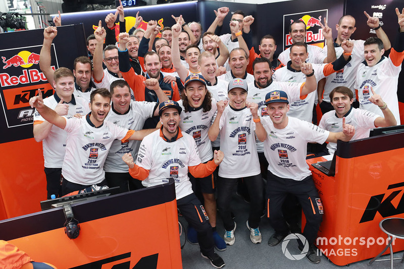 Miguel Oliveira, Can Oncu, and Red Bull KTM Ajo team members celebrate