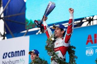 Lucas Di Grassi, Audi Sport ABT Schaeffler, celebrates with his trophy on the podium.