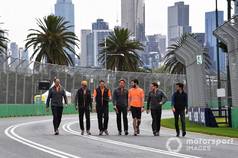 Carlos Sainz Jr., McLaren, walks the track with his team