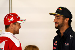 Sebastian Vettel, Scuderia Ferrari talks with Daniel Ricciardo, Red Bull Racing