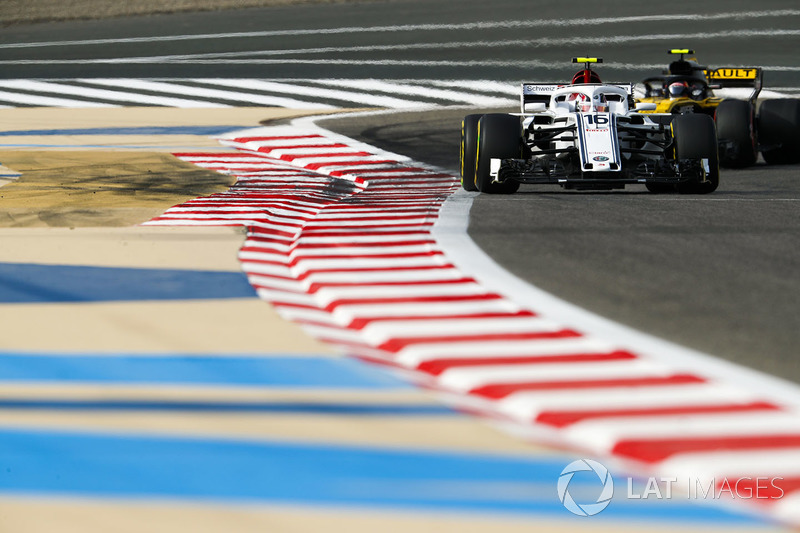 Charles Leclerc, Sauber C37 Ferrari, leads Carlos Sainz Jr., Renault Sport F1 Team R.S. 18