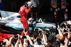 Sebastian Vettel, Ferrari SF70H, celebrates as he climbs from his car after winning the race