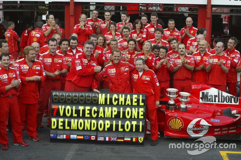 Michael Schumacher, Ferrari F2004 celebrates with the Ferrari team after winning his 7th world champ