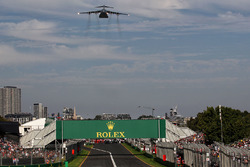 A large plane flies over the circuit
