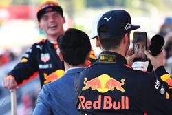 Daniel Ricciardo, Red Bull Racing celebrates with Lewis Hamilton's phone on the podium