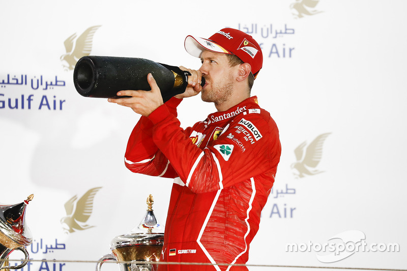 Podium: race winner Sebastian Vettel, Ferrari drinks Rose Water