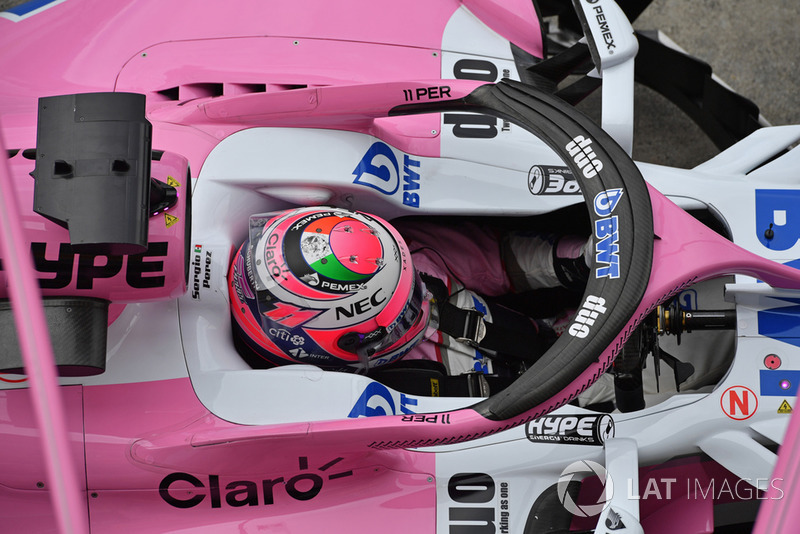 Sergio Perez, Racing Point Force India VJM11 driving into his pit box