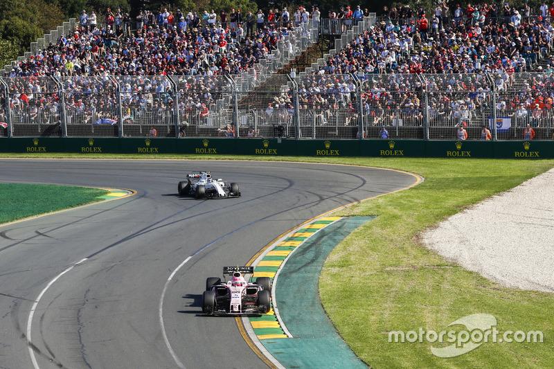 Esteban Ocon, Force India VJM10, leads Lance Stroll, Williams FW40