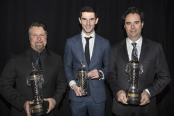 2016 Indy 500 winner Alexander Rossi, team owner Michael Andretti and co-entrant Bryan Herta with their baby Borg-Warner Trophies