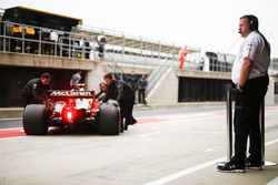 Zak Brown, Executive Director, McLaren Technology Group, looks on as Stoffel Vandoorne, McLaren MCL3