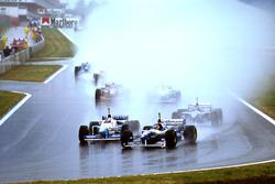 Jacques Villeneuve, Williams FW18 Renault with Jean Alesi, Benetton B196 Renault
