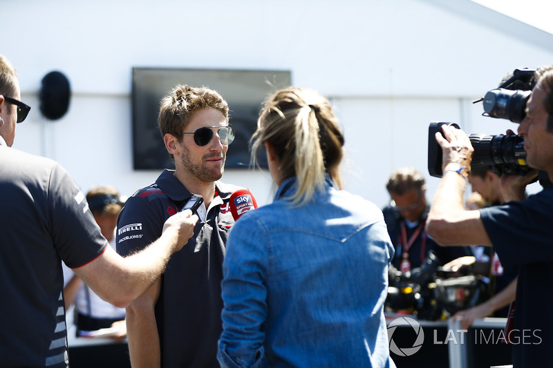 Romain Grosjean, Haas F1 Team, talks to the media in qualifying