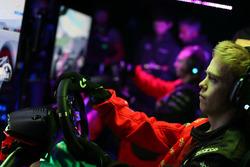Mika Hakkinen with McLaren World's Fastest Gamer participant