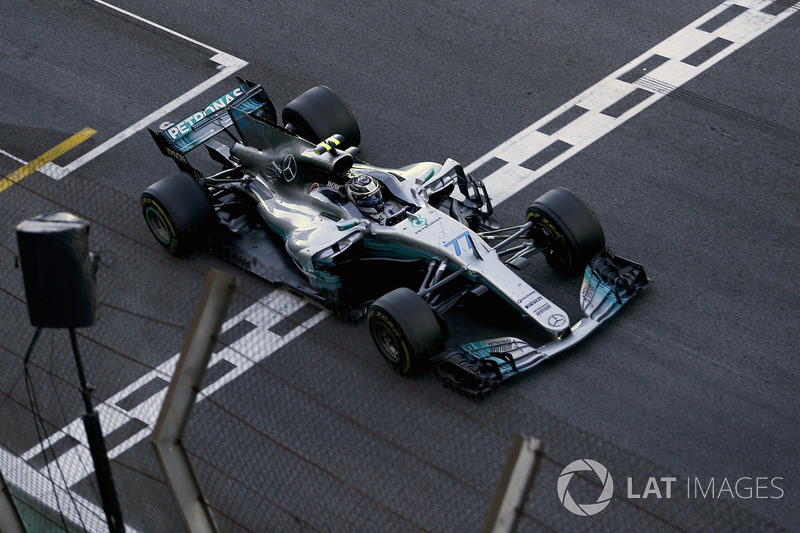Valtteri Bottas, Mercedes-Benz F1 W08 crosses the line to take the chequered flag and Second place