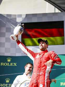 Sebastian Vettel, Ferrari, 2nd position, with his trophy on the podium