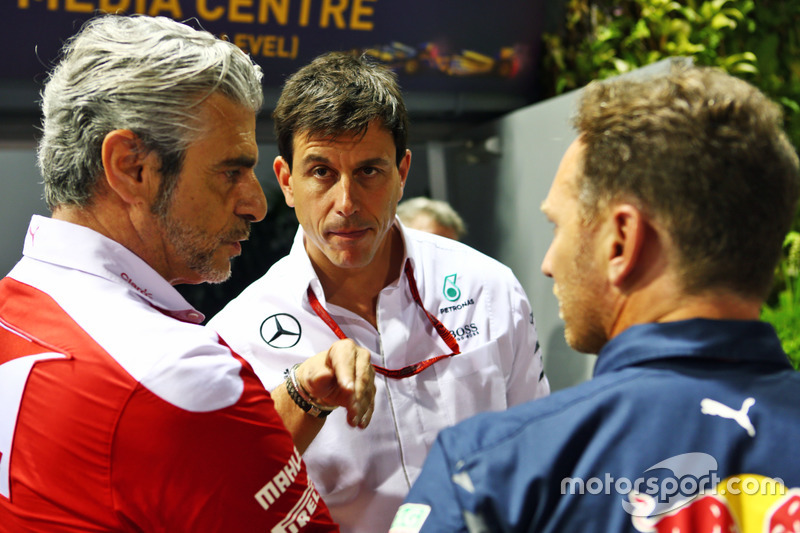 (L to R): Maurizio Arrivabene, Ferrari Team Principal with Toto Wolff, Mercedes AMG F1 Shareholder a