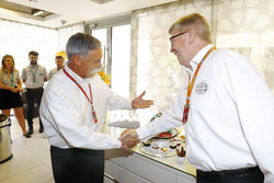 Chase Carey, Chairman, Formula One, greets Ross Brawn, Managing Director of Motorsports, FOM
