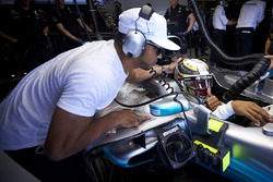 Nicolas Hamilton leans in to the car of his brother Lewis Hamilton, Mercedes AMG F1 W08