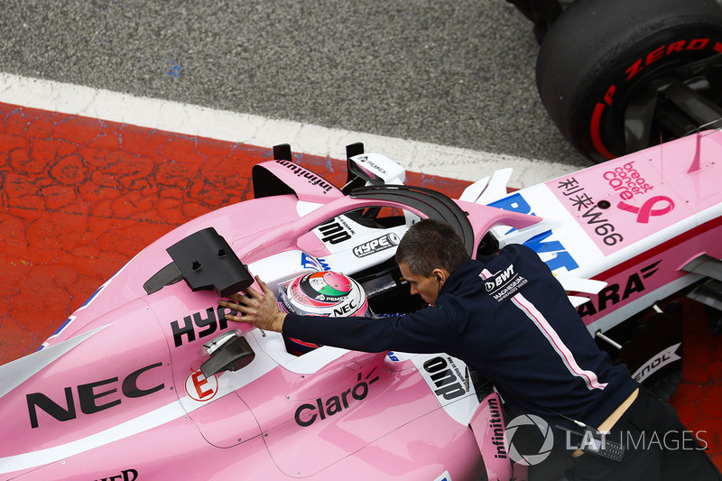 Sergio Perez, Force India, is pushed into his garage in the pit lane