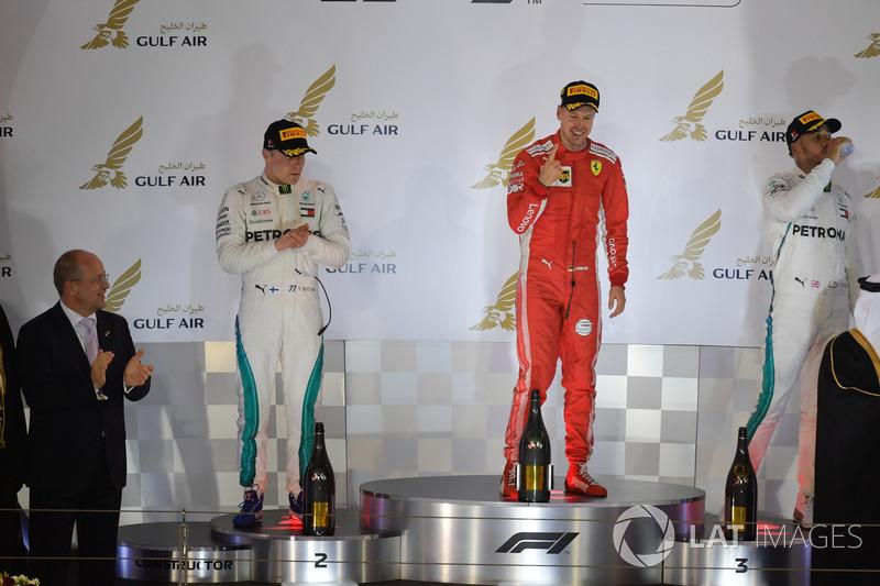 Sebastian Vettel, Ferrari, Valtteri Bottas, Mercedes-AMG F1 and Lewis Hamilton, Mercedes-AMG F1 cele