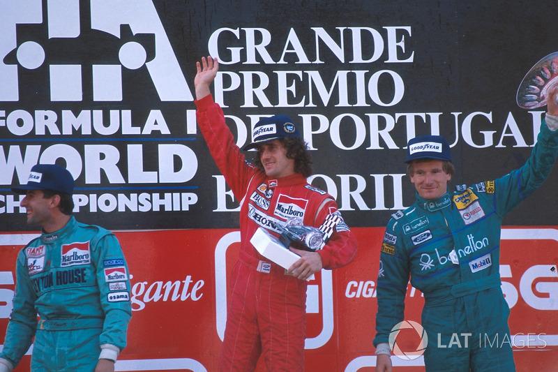 Podium: race winner Alain Prost, second place Ivan Capelli, third place Thierry Boutsen