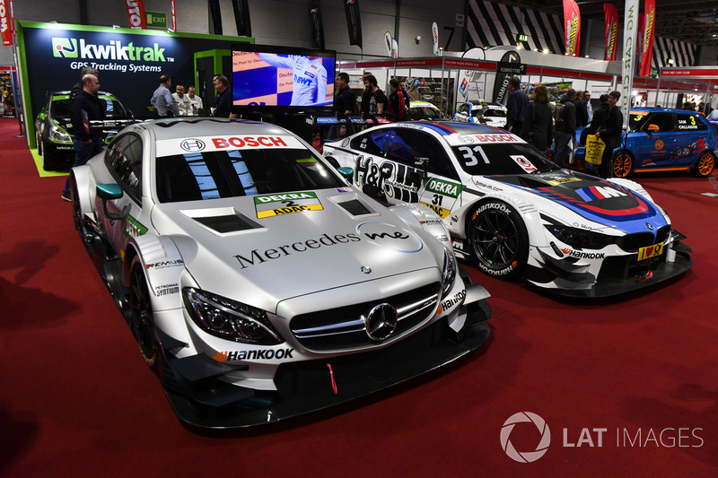 A DTM BMW and Mercedes on display