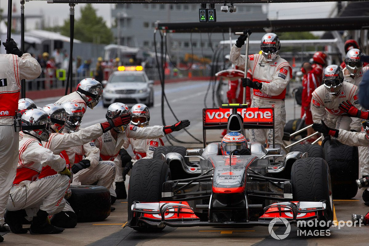 Jenson Button, McLaren MP4-26 Mercedes, leaves the pits after making a pit stop for a new front wing