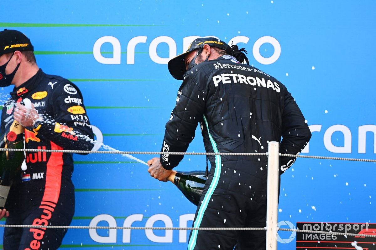 Max Verstappen, Red Bull Racing, 2nd position, Lewis Hamilton, Mercedes-AMG Petronas F1, 1st position, celebrate with Champagne