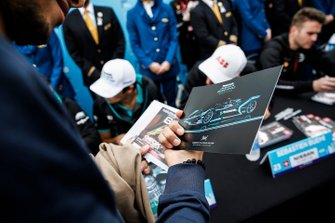 A fan admires the Panasonic Jaguar Racing autograph card