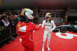 Sebastian Vettel, Ferrari congratulates Lewis Hamilton, Mercedes AMG, in parc ferme after the race