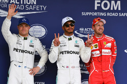 (L to R): Valtteri Bottas, Mercedes AMG F1, pole sitter Lewis Hamilton, Mercedes AMG F1 and Sebastian Vettel, Ferrari celebrate in parc ferme