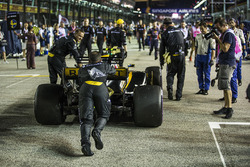 The car of Jolyon Palmer, Renault Sport F1 Team RS17 is pushed by mechanics