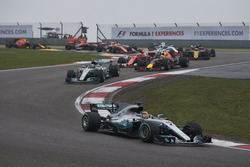 Lewis Hamilton, Mercedes AMG F1 W08, leads Sebastian Vettel, Ferrari SF70H, Valtteri Bottas, Mercedes AMG F1 W08, Daniel Ricciardo, Red Bull Racing RB13, Kimi Raikkonen, Ferrari SF70H, at the start
