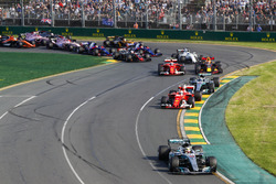 Lewis Hamilton, Mercedes AMG F1 W08, leads the field through the first corner