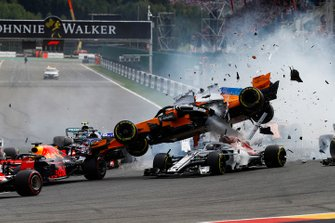 Fernando Alonso, McLaren MCL33, crashes over Charles Leclerc, Alfa Romeo Sauber C37, after contact from Nico Hulkenberg, Renault Sport F1 Team R.S. 18, at the start