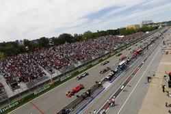 Sebastian Vettel, Ferrari SF71H, leads at the start from Valtteri Bottas, Mercedes AMG F1 W09, Max Verstappen, Red Bull Racing RB14, Lewis Hamilton, Mercedes AMG F1 W09, Kimi Raikkonen, Ferrari SF71H, Daniel Ricciardo, Red Bull Racing RB14 and the rest of