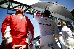 Kimi Raikkonen, Ferrari, and Lewis Hamilton, Mercedes AMG F1, on the grid