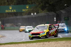 Chaz Mostert, Tickford Racing Ford, leads Nick Percat, Brad Jones Racing Holden