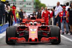 Sebastian Vettel, Ferrari SF71H, 1st position, drives into Parc Ferme