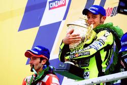 Подіум: переможець Валентино Россі, Honda Team, Макс Б'яджі, Yamaha Team