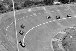 Tony Brooks, Ferrari Dino 246 lidera a Stirling Moss, Cooper T51 Climax