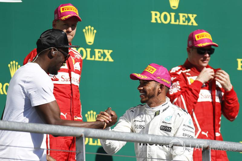 Podio: ganador de la carrera Lewis Hamilton, Mercedes AMG F1, segundo lugar Sebastian Vettel, Ferrari, tercer lugar Kimi Raikkonen, Ferrari y Usain Bolt