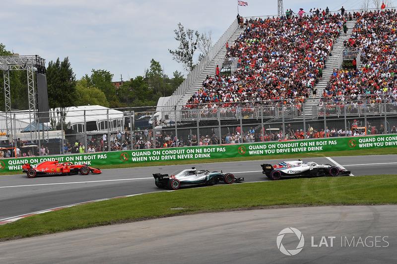 Kimi Raikkonen, Ferrari SF71H exits pit lane behind Lewis Hamilton, Mercedes-AMG F1 W09