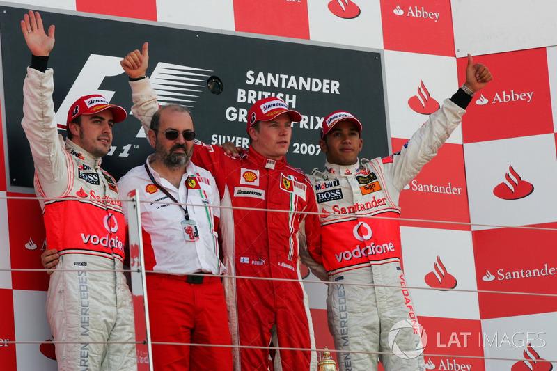 Podium: second place Fernando Alonso, McLaren, Gilles Simon, Ferrari Engine Department, Race winner Kimi Raikkonen, Ferrari, third place Lewis Hamilton, McLaren