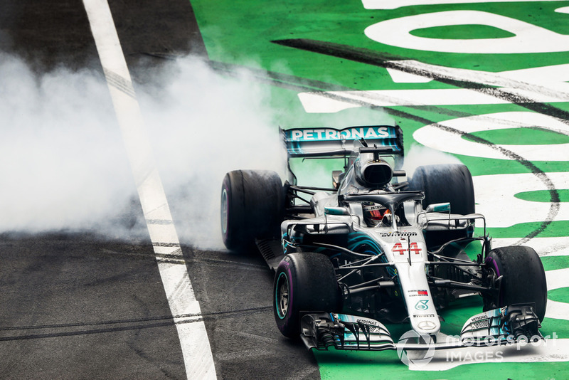 Lewis Hamilton, Mercedes, performs donuts in celebration of securing his fifth world drivers championship title